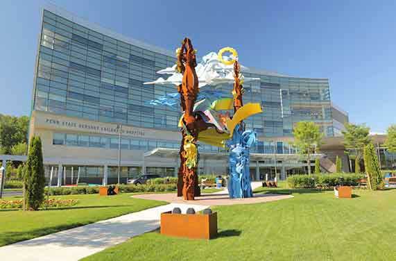 A large and colorful metal sculpture greets patients and visitors to Penn State Health Children's Hospital