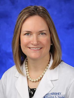 April Armstrong, MD pictured in a professional head and shoulders photo