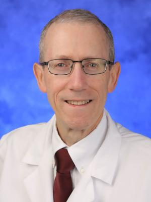 A head-and-shoulders photo of  Zachary Simmons, MD