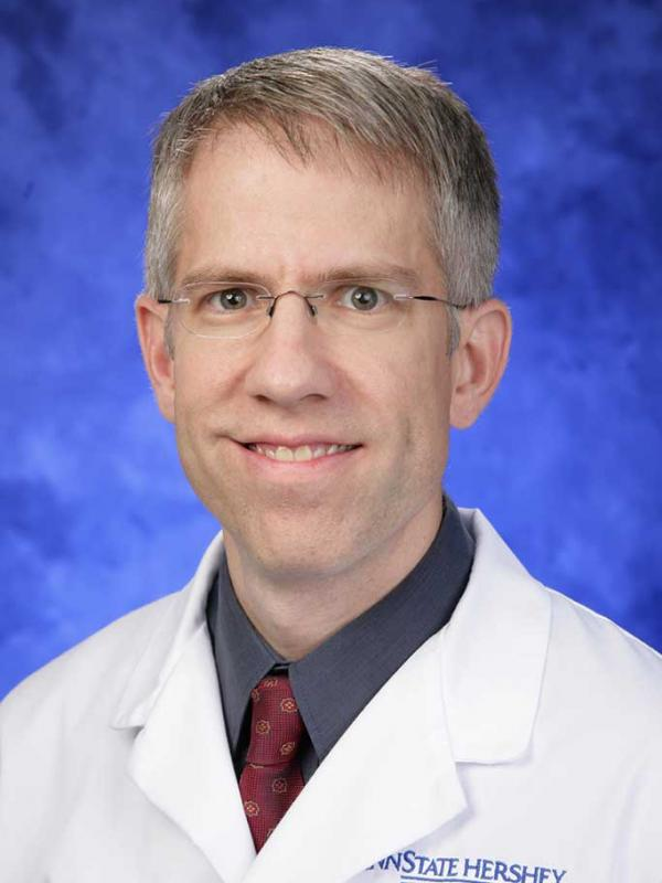 A head-and-shoulders photo of Edward J. Gunther, MD