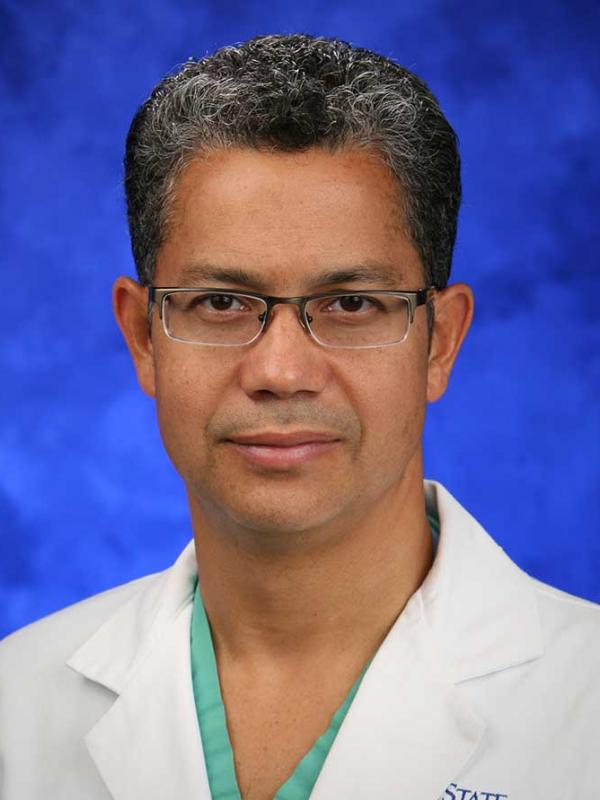 A head-and-shoulders photo of Kevin M. Cockroft, MD, MSc, FAANS, FACS, FAHA