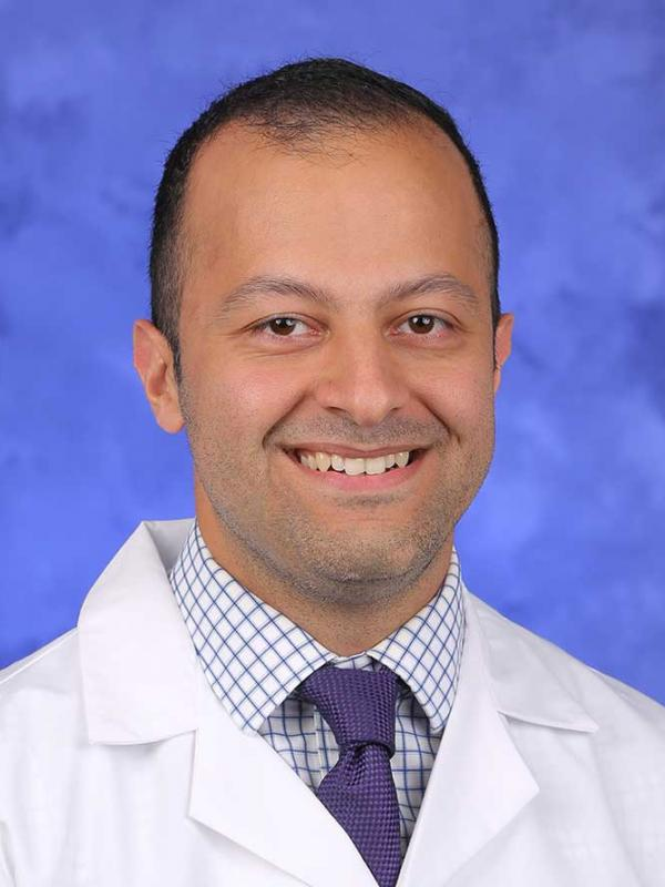 A head-and-shoulders photo of Seyed A. Mansouri, MD