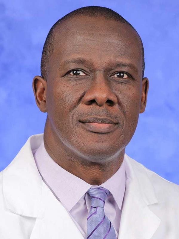 A head-and-shoulders photo of Kofi Clarke, MD, FACP, FRCP, AGAF