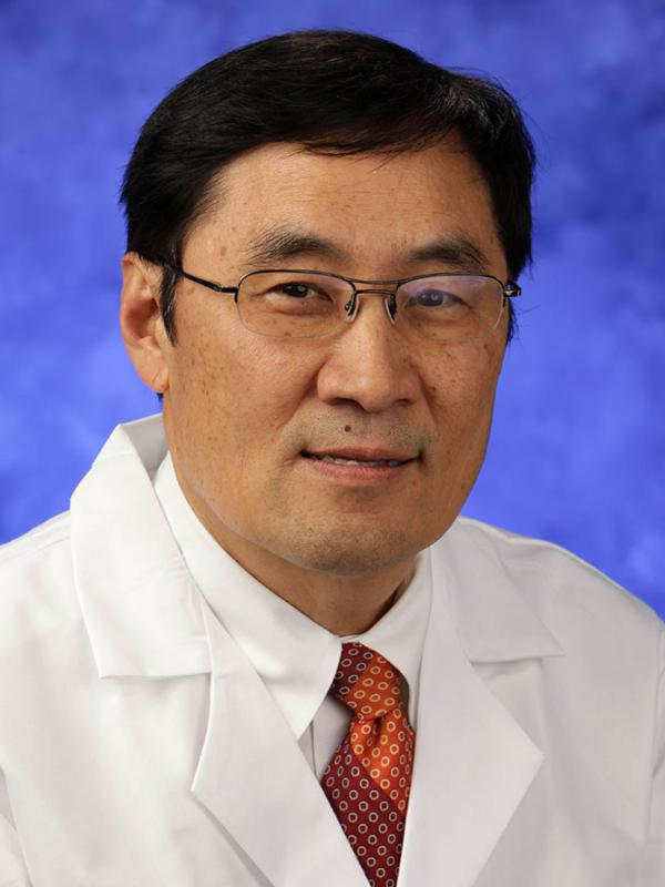 A head-and-shoulders photo of Thomas Y. Ma, MD, PhD