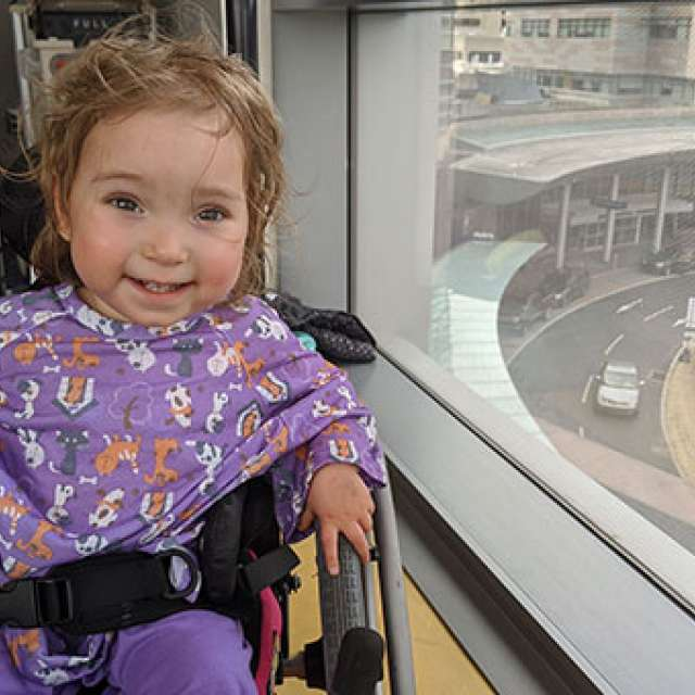 Young girl smiling in her wheelchair
