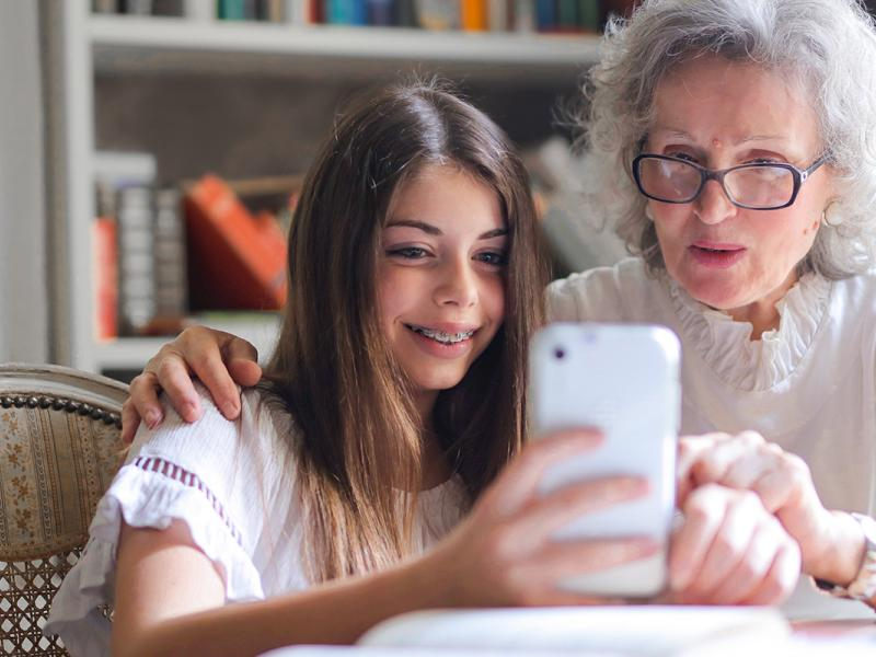 A granddaughter and grandmother use the OnDemand app