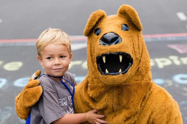 Young boy posing with the Penn State Nittany Lion